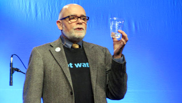 "Michael E. Campana, Ph.D, presents his ""H2O Talk"" on ""hydrophilanthropy."" The NGWA modeled the new addition to their opening ceremony after the famous TED Talks."