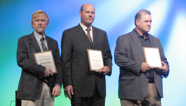 Scott Tyler, Ph.D, Brent Murray and Michael Benet accept divisional awards