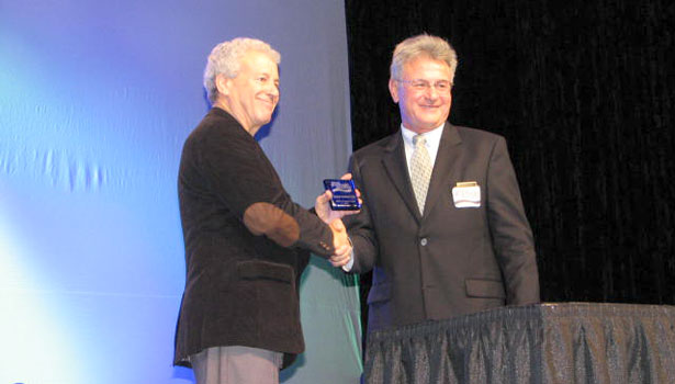 Dr. Leonard Konikow of USGS, left, accepts one of the Life Member Awards from NGWA President Daniel T. Meyer.