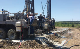 Side-by-side rigs install geothermal boreholes