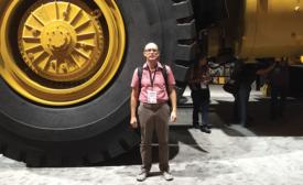 Jeremy Verdusco next to massive dump truck