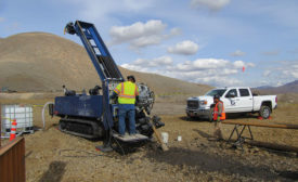 Gregory drilling crew in the field