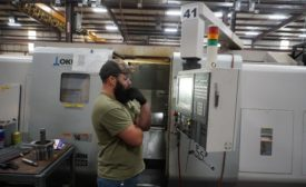 Brandon Lamar of Matrix Drilling Products operates one of the company's CNC machines