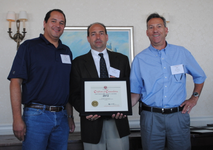 Rick Galletta, left, and John Capasso, right, receive the AGC award from Todd McDermott of AON Construction Services Group. Source: MD Drilling